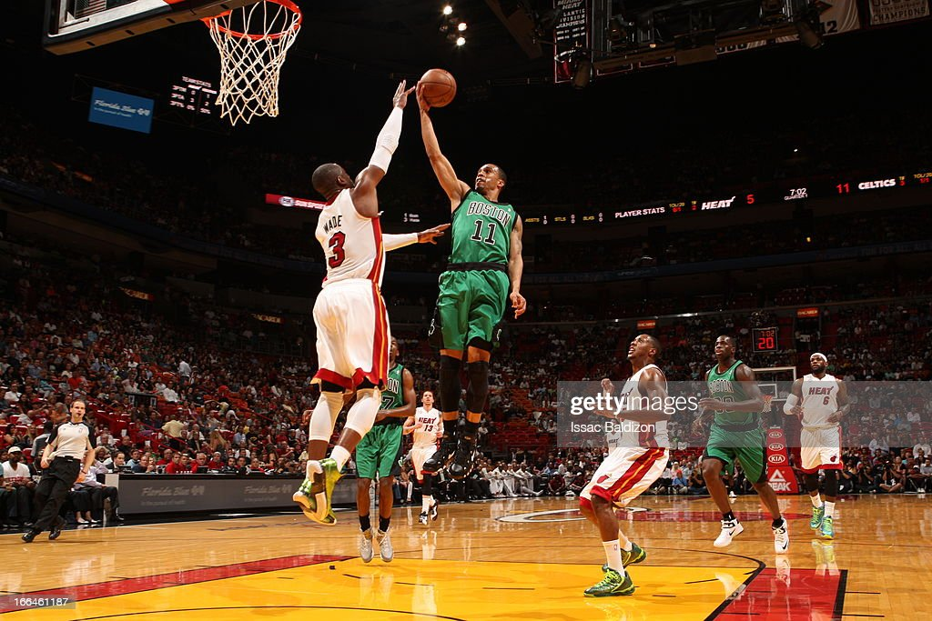 Courtney Lee #11 of the Boston Celtics goes to the basket against Dwyane Wade #3 of the Miami Heat on April 12, 2013 at American Airlines Arena in Miami, Florida.
