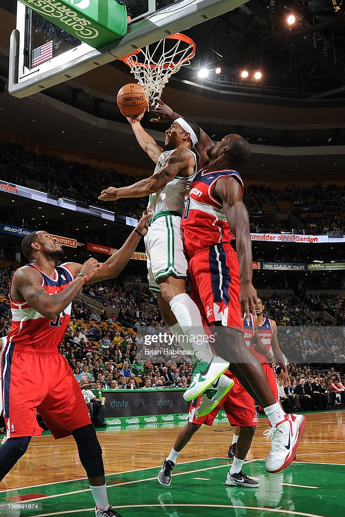 Courtney Lee #11 of the Boston Celtics goes to the basket against Emeka Okafor #50 of the Washington Wizards on November 7, 2012 at the TD Garden in Boston, Massachusetts.