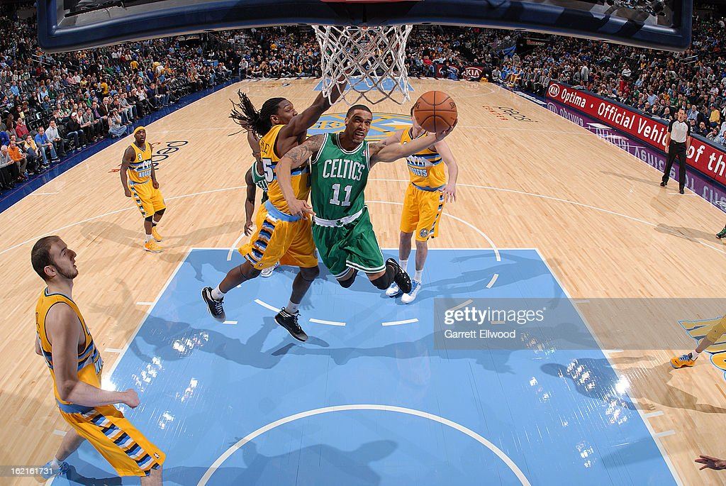 Courtney Lee #11 of the Boston Celtics goes to the basket against Kenneth Faried #35 of the Denver Nuggets on February 19, 2013 at the Pepsi Center in Denver, Colorado.