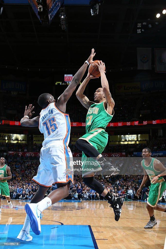 Courtney Lee #11 of the Boston Celtics goes to the basket against Reggie Jackson #15 of the Oklahoma City Thunder during the game between the Oklahoma City Thunder and the Boston Celtics on March 10, 2013 at the Chesapeake Energy Arena in Oklahoma City, Oklahoma.