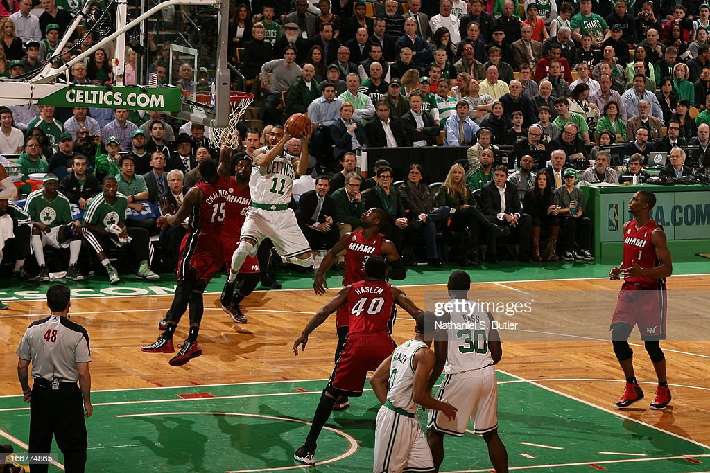 <a gi-track='captionPersonalityLinkClicked' href=/galleries/search?phrase=Courtney+Lee&family=editorial&specificpeople=730223 ng-click='$event.stopPropagation()'>Courtney Lee</a> #11 of the Boston Celtics goes to the basket for the score against the Miami Heat during a game on March 18, 2013 at TD Garden in Boston, Massachusetts.