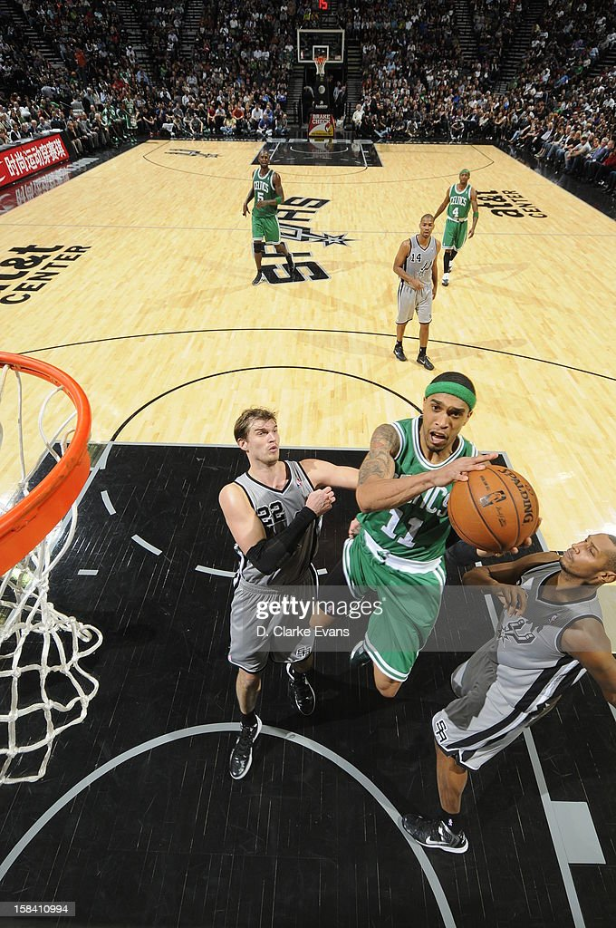 <a gi-track='captionPersonalityLinkClicked' href=/galleries/search?phrase=Courtney+Lee&family=editorial&specificpeople=730223 ng-click='$event.stopPropagation()'>Courtney Lee</a> #11 of the Boston Celtics goes to the basket under pressure during the game between the Boston Celtics and the San Antonio Spurs on December 15, 2012 at the AT&T Center in San Antonio, Texas.