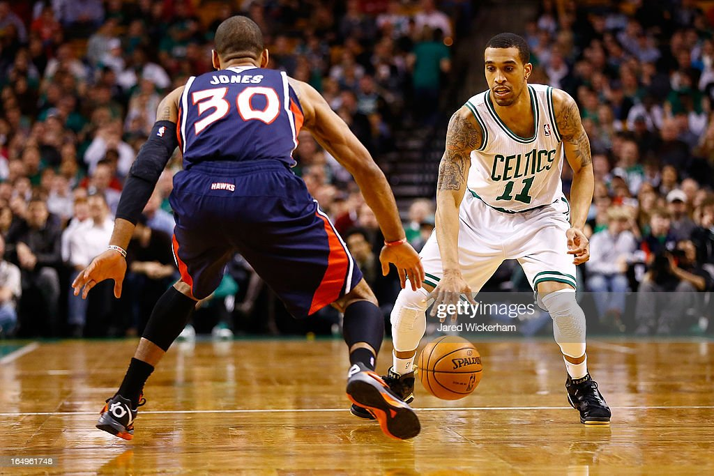 Courtney Lee #11 of the Boston Celtics handles the ball against Dahntay Jones #30 of the Atlanta Hawks during the game on March 29, 2013 at TD Garden in Boston, Massachusetts.