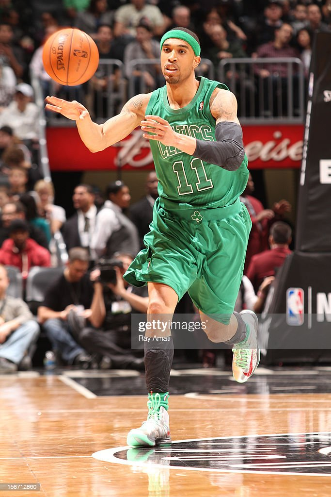 <a gi-track='captionPersonalityLinkClicked' href=/galleries/search?phrase=Courtney+Lee&family=editorial&specificpeople=730223 ng-click='$event.stopPropagation()'>Courtney Lee</a> #11 of the Boston Celtics passes the ball against the Brooklyn Nets on December 25, 2012 at the Barclays Center in Brooklyn, New York.