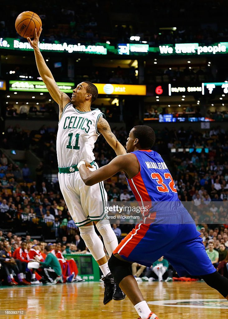 Courtney Lee #11 of the Boston Celtics passes the ball in front of Khris Middleton #32 of the Detroit Pistons during the game on April 3, 2013 at TD Garden in Boston, Massachusetts.
