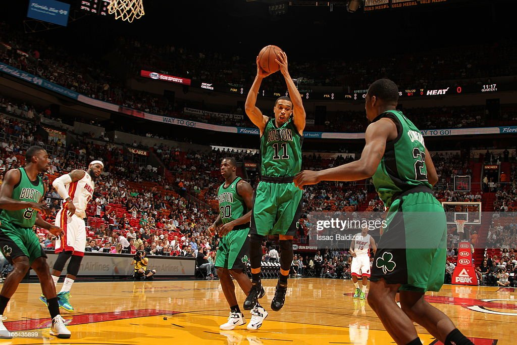 Courtney Lee #11 of the Boston Celtics rebounds against the Miami Heat on April 12, 2013 at American Airlines Arena in Miami, Florida.