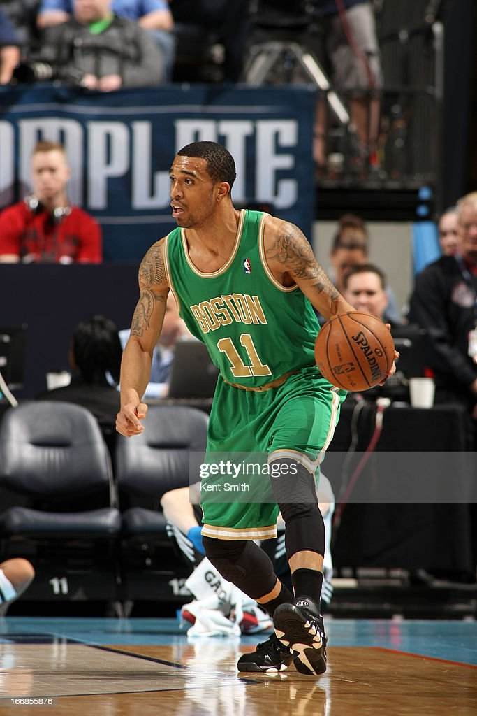 Courtney Lee #11 of the Boston Celtics scans the court while looking to pass the ball against of the Charlotte Bobcats at the Time Warner Cable Arena on March 12, 2013 in Charlotte, North Carolina.