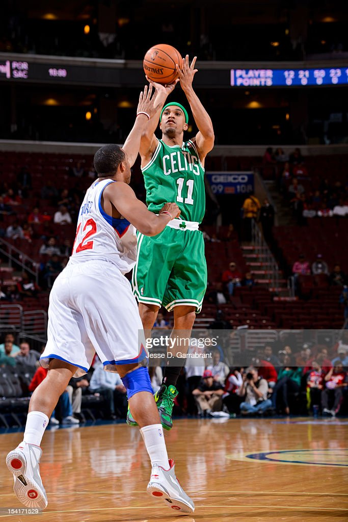Courtney Lee #11 of the Boston Celtics shoots against Evan Turner #12 of the Philadelphia 76ers during a pre-season game at the Wells Fargo Center on October 15, 2012 in Philadelphia, Pennsylvania.