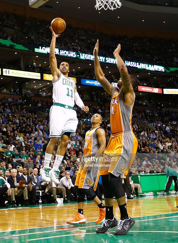 Courtney Lee #11 of the Boston Celtics takes a shot against the Phoenix Suns before injuring himself after falling into a court side seat during the game on January 9, 2013 at TD Garden in Boston, Massachusetts.