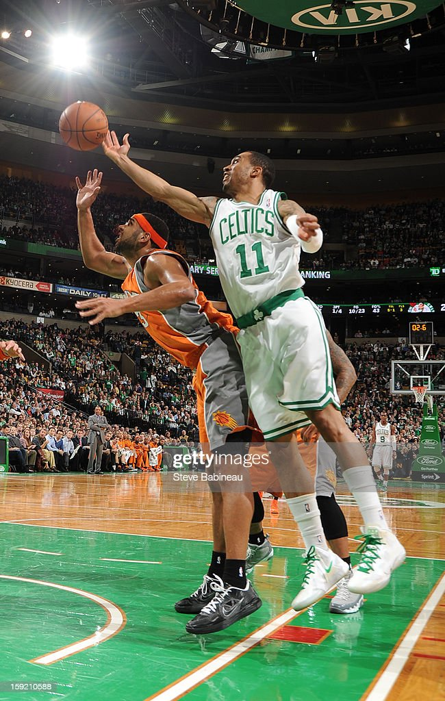 Courtney Lee #11 of the Boston Celtics tries to grab the rebound over Jared Dudley #3 of the Phoenix Suns on January 9, 2013 at the TD Garden in Boston, Massachusetts.