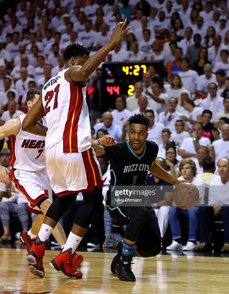<a gi-track='captionPersonalityLinkClicked' href=/galleries/search?phrase=Courtney+Lee&family=editorial&specificpeople=730223 ng-click='$event.stopPropagation()'>Courtney Lee</a> #1 of the Charlotte Hornets drives on <a gi-track='captionPersonalityLinkClicked' href=/galleries/search?phrase=Hassan+Whiteside&family=editorial&specificpeople=7068411 ng-click='$event.stopPropagation()'>Hassan Whiteside</a> #21 of the Miami Heat during Game Seven of the Eastern Conference Quarterfinals of the 2016 NBA Playoffs at American Airlines Arena on May 1, 2016 in Miami, Florida.