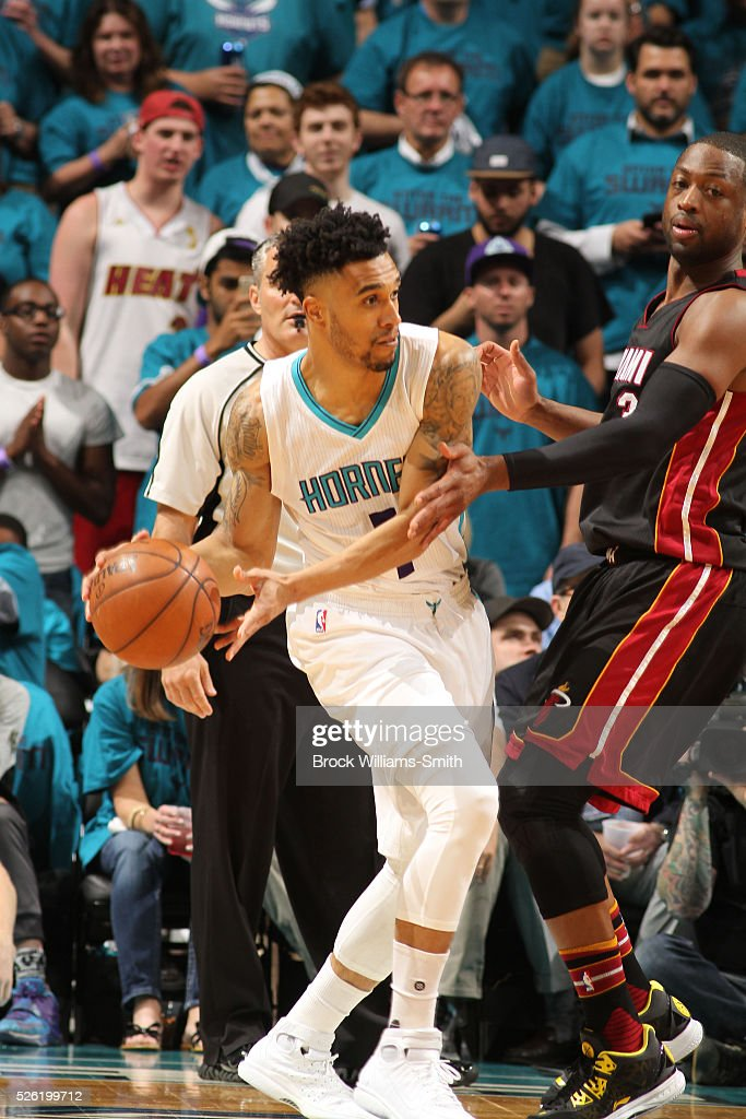 <a gi-track='captionPersonalityLinkClicked' href=/galleries/search?phrase=Courtney+Lee&family=editorial&specificpeople=730223 ng-click='$event.stopPropagation()'>Courtney Lee</a> #1 of the Charlotte Hornets passes the ball against Dwyane Wade #3 of the Miami Heat in Game Six of the Eastern Conference Quarterfinals during the 2016 NBA Playoffs on April 29, 2016 at Time Warner Cable Arena in Charlotte, North Carolina.