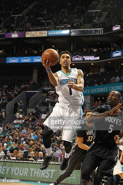 Courtney Lee of the Charlotte Hornets shoots against Gorgui Dieng of the Minnesota Timberwolves during the game at the Time Warner Cable Arena on...