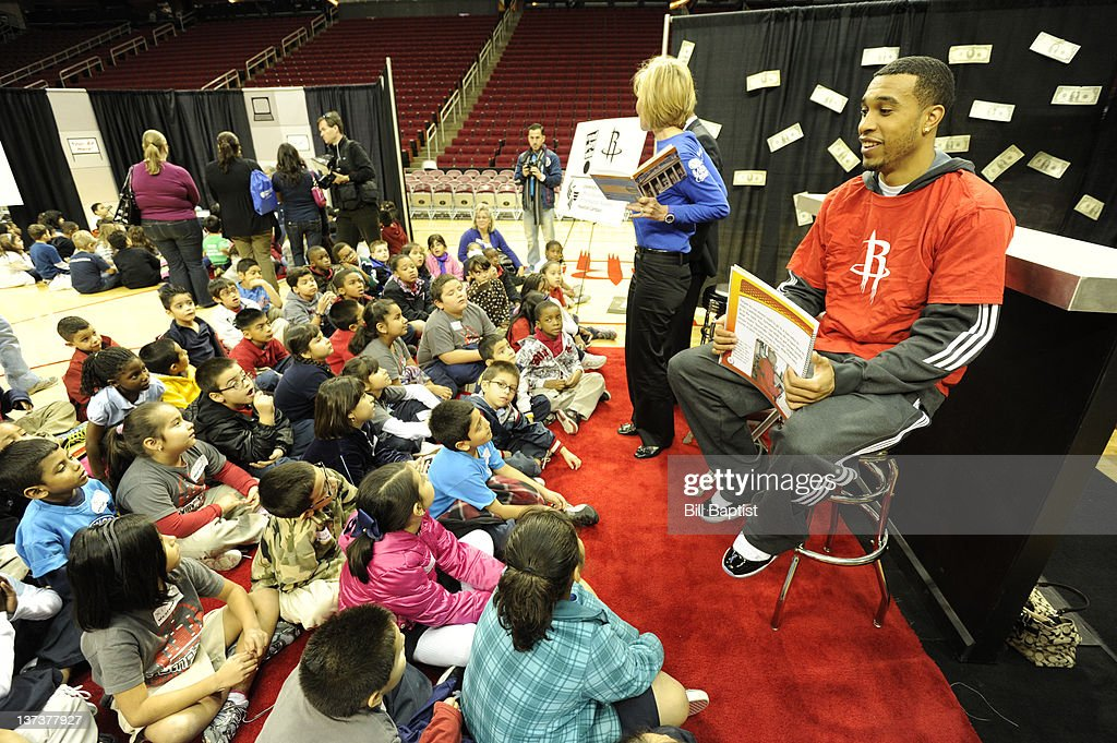 <a gi-track='captionPersonalityLinkClicked' href=/galleries/search?phrase=Courtney+Lee&family=editorial&specificpeople=730223 ng-click='$event.stopPropagation()'>Courtney Lee</a> #5 of the Houston Rockets reads to children during Read Play Win on January 18, 2012 at the Toyota Center in Houston, Texas.
