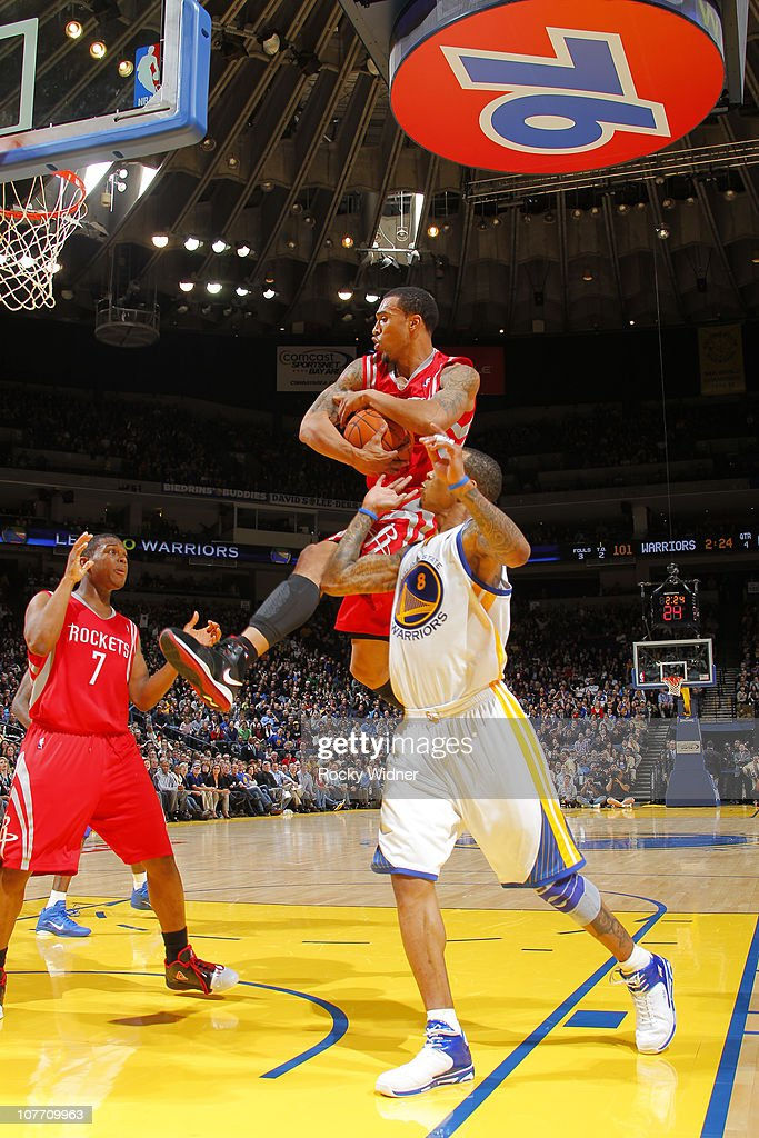 Courtney Lee #5 of the Houston Rockets secures a rebound against Monta Ellis #8 of the Golden State Warriors on December 20, 2010 at Oracle Arena in Oakland, California.
