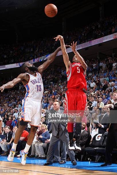 Courtney Lee of the Houston Rockets shoots a winning 3pointer over James Harden of the Oklahoma City Thunder during the game between the Oklahoma...