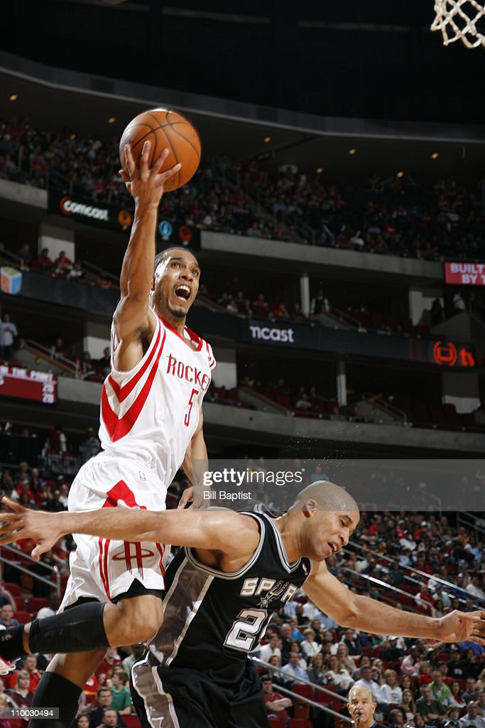 <a gi-track='captionPersonalityLinkClicked' href=/galleries/search?phrase=Courtney+Lee&family=editorial&specificpeople=730223 ng-click='$event.stopPropagation()'>Courtney Lee</a> #5 of the Houston Rockets shoots the ball over <a gi-track='captionPersonalityLinkClicked' href=/galleries/search?phrase=Richard+Jefferson&family=editorial&specificpeople=201688 ng-click='$event.stopPropagation()'>Richard Jefferson</a> #24 of the San Antonio Spurs on March 12, 2011 at the Toyota Center in Houston, Texas.