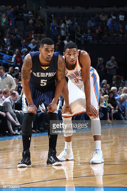 Courtney Lee of the Memphis Grizzlies and Andre Roberson of the Oklahoma City Thunder during the game on October 14 2014 at the Chesapeake Energy...