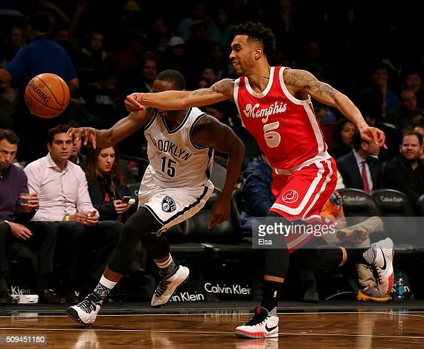 Courtney Lee of the Memphis Grizzlies swats the ball away from Donald Sloan of the Brooklyn Nets on February 102016 at the Barclays Center in the...