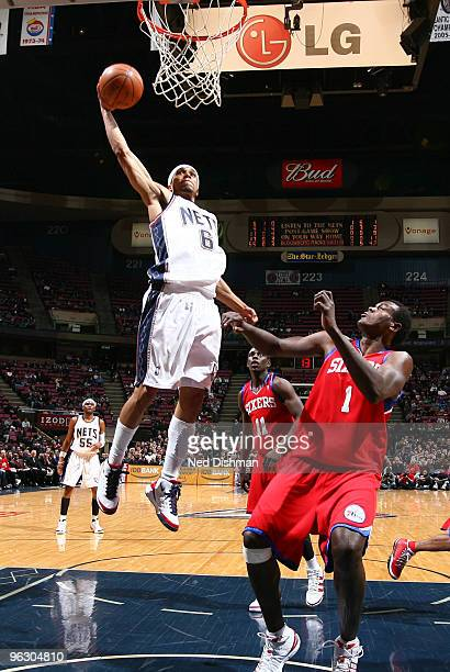 Courtney Lee of the New Jersey Nets dunks against Samuel Dalembert of the Philadelphia 76ers on January 31 2010 at the IZOD Center in East Rutherford...