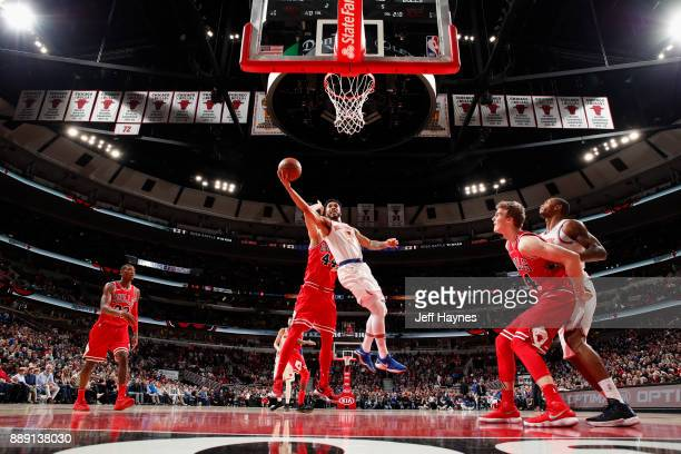 Courtney Lee of the New York Knicks goes to the basket against the Chicago Bulls on December 9 2017 at the United Center in Chicago Illinois NOTE TO...