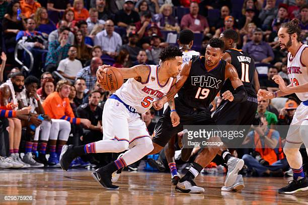 Courtney Lee of the New York Knicks handles the ball against Leandro Barbosa of the Phoenix Suns during a game on December 13 2016 at Talking Stick...