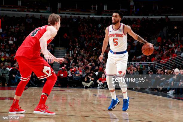 Courtney Lee of the New York Knicks handles the ball against the Chicago Bulls on December 9 2017 at the United Center in Chicago Illinois NOTE TO...
