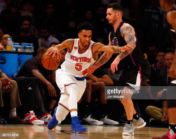Courtney Lee of the New York Knicks in action against JJ Redick of the Los Angeles Clippers at Madison Square Garden on February 8 2017 in New York...