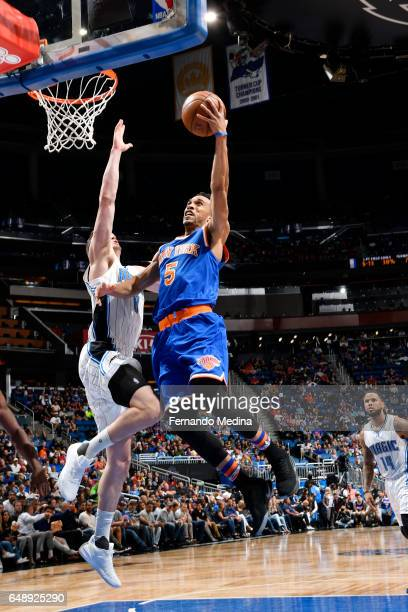 Courtney Lee of the New York Knicks shoots a lay up against the Orlando Magic during the game on March 6 2017 at Amway Center in Orlando Florida NOTE...