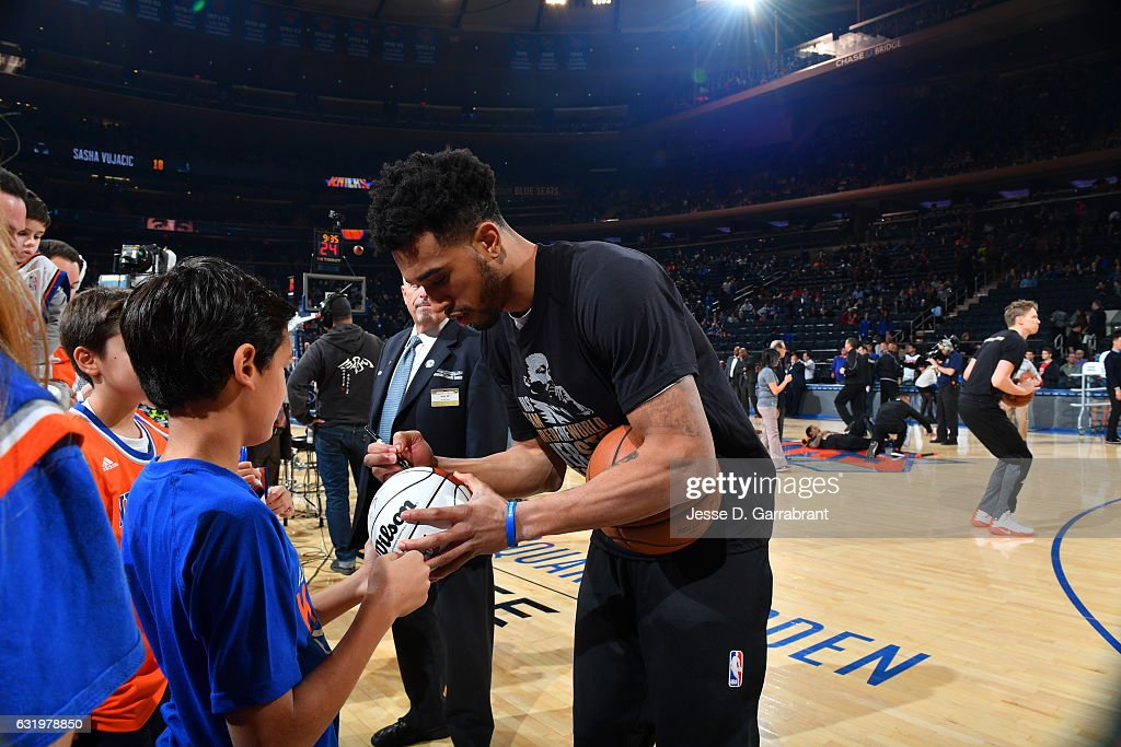 Courtney Lee #5 of the New York Knicks signs autographs before the game against the Atlanta Hawks on January 16, 2017 at Madison Square Garden in New York, New York.