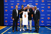 Courtney Lee poses with New York Knicks President Phil Jackson General Manager Steve Mills and Head Coach Jeff Hornacek at a press conference at the...