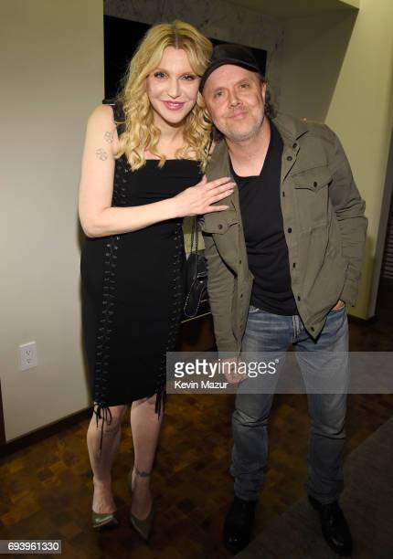 Courtney Love and musician Lars Ulrich of Metallica pose backstage at Moschino Spring/Summer 18 Menswear and Women's Resort Collection at Milk...