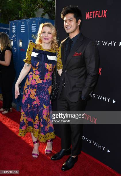 Courtney Love and Ross Butler arrives at the Premiere Of Netflix's '13 Reasons Why' at Paramount Pictures on March 30 2017 in Los Angeles California