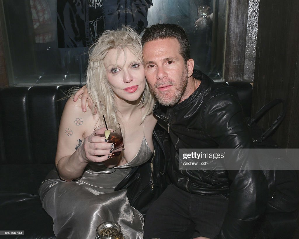 Courtney Love and Scott Lipps, CEO of One Management, attend the 'Popplicks: Plus One' Book Launch Event at The Gallery at The Dream Downtown Hotel on September 9, 2013 in New York, United States.