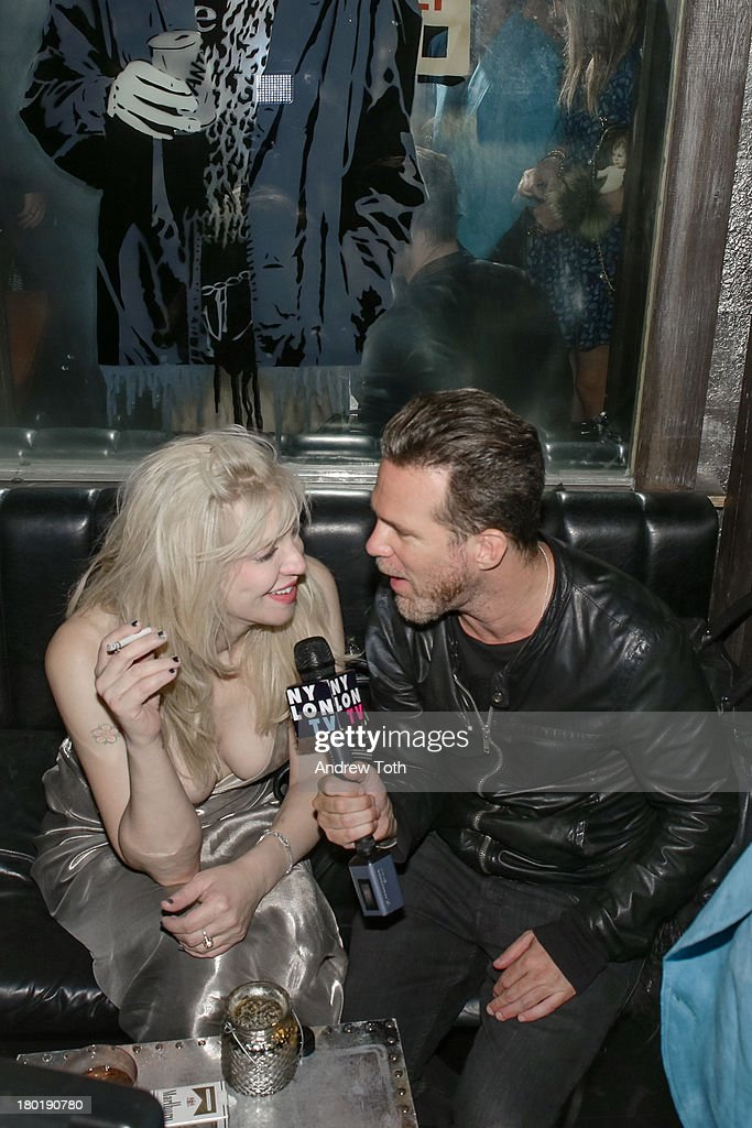 <a gi-track='captionPersonalityLinkClicked' href=/galleries/search?phrase=Courtney+Love&family=editorial&specificpeople=156418 ng-click='$event.stopPropagation()'>Courtney Love</a> and Scott Lipps, CEO of One Management, attend the 'Popplicks: Plus One' Book Launch Event at The Gallery at The Dream Downtown Hotel on September 9, 2013 in New York, United States.