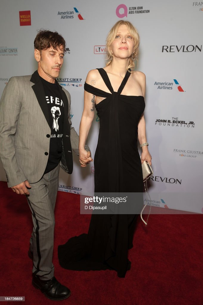 Courtney Love (R) and Steven Klein attend the Elton John AIDS Foundation's 12th Annual An Enduring Vision Benefit at Cipriani Wall Street on October 15, 2013 in New York City.