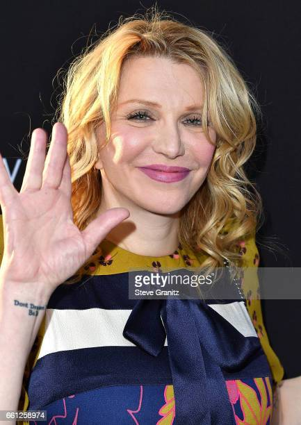 Courtney Love arrives at the Premiere Of Netflix's '13 Reasons Why' at Paramount Pictures on March 30 2017 in Los Angeles California