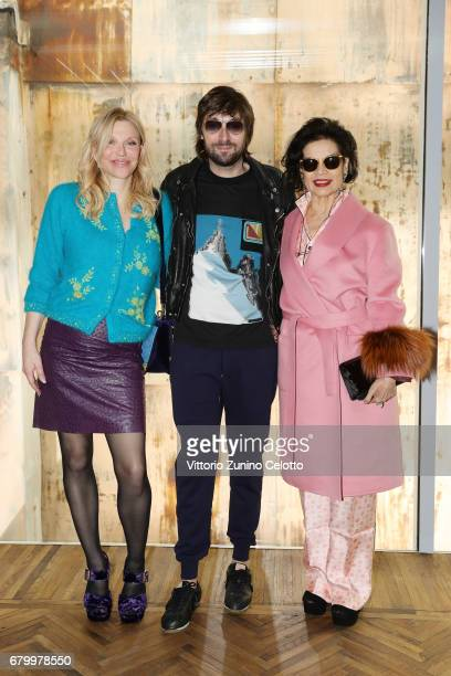 Courtney Love Francesco Vezzoli and Bianca Jagger while attending the Prada Resort 2018 Womenswear Show in Osservatorio on May 7 2017 in Milan Italy