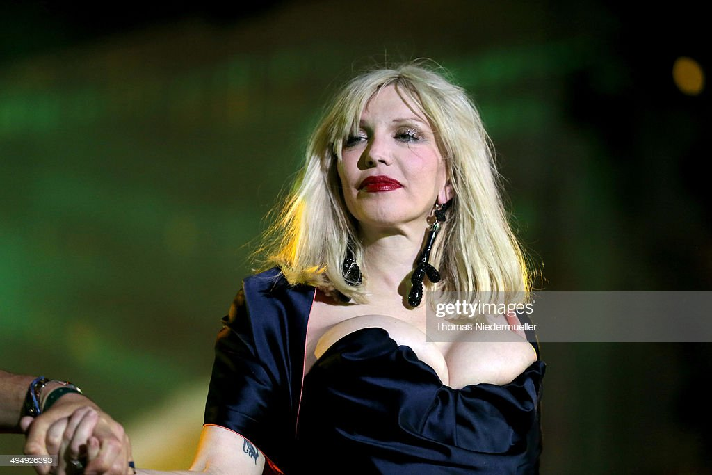 <a gi-track='captionPersonalityLinkClicked' href=/galleries/search?phrase=Courtney+Love&family=editorial&specificpeople=156418 ng-click='$event.stopPropagation()'>Courtney Love</a> is seen on stage during the Lifeball 2014 at City Hall on May 31, 2014 in Vienna, Austria.
