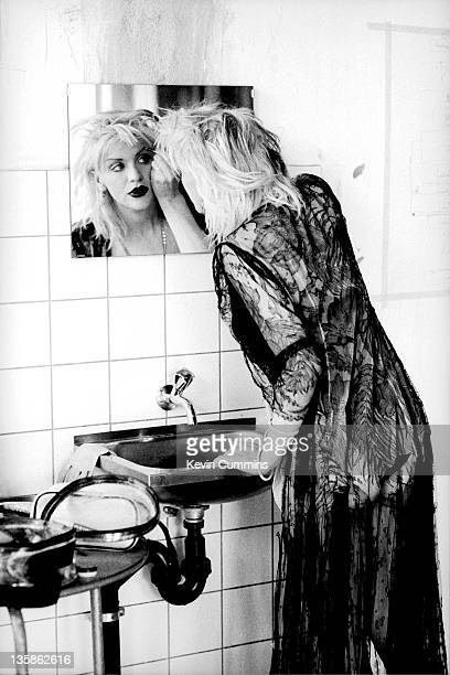 Courtney Love of Hole applies makeup in a mirror backstage before a concert at Rote Fabrik in Zurich Switzerland 13th April 1995