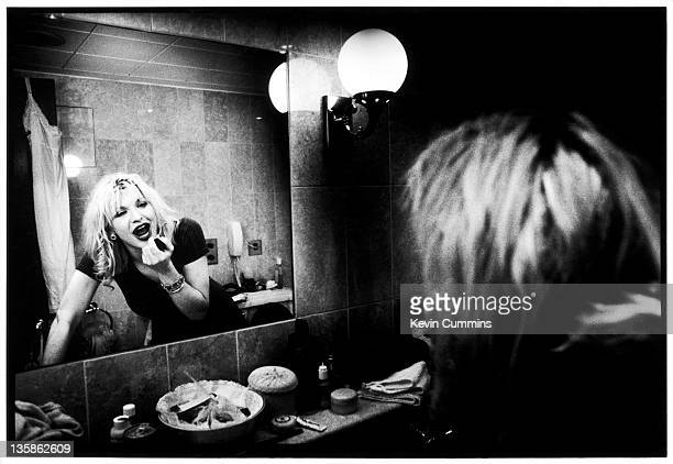 Courtney Love of Hole applies makeup in a mirror in the bathroom of the Milestone Hotel London 28th August 2004