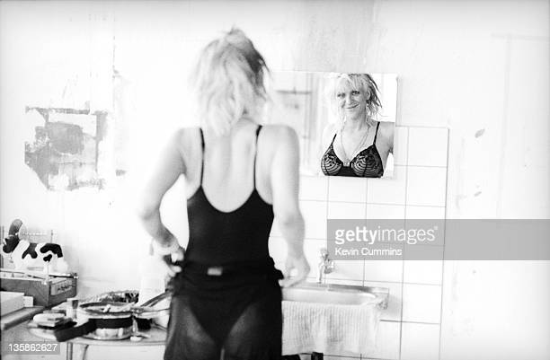Courtney Love of Hole looks in a mirror backstage before a concert at Rote Fabrik in Zurich Switzerland 13th April 1995