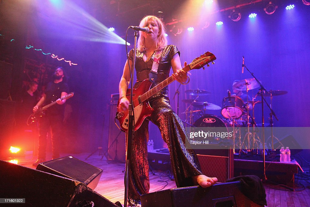 <a gi-track='captionPersonalityLinkClicked' href=/galleries/search?phrase=Courtney+Love&family=editorial&specificpeople=156418 ng-click='$event.stopPropagation()'>Courtney Love</a> performs during the 'I'm Still Alive' tour at Warsaw in Greenpoint, Brooklyn on June 26, 2013 in New York City.
