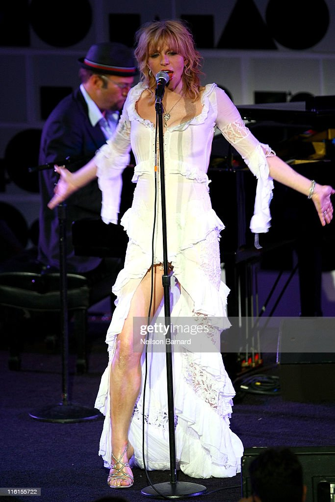 Courtney Love performs on stage during the 2nd Annual amfAR Inspiration Gala at The Museum of Modern Art on June 14, 2011 in New York City.