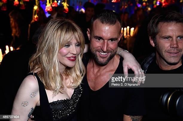 Courtney Love Philipp Plein and Emanuele Filiberto di Savoia attend the Philipp Plein show during the Milan Fashion Week Spring/Summer 2016 on...