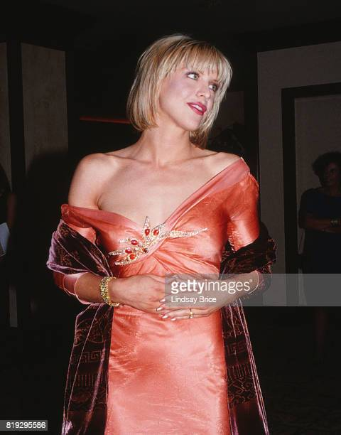 Courtney Love poses for photographs as she arrives at ACLU Torch of Liberty Dinner at the Century Plaza Hotel Los Angeles on May 21 1997 in Los...