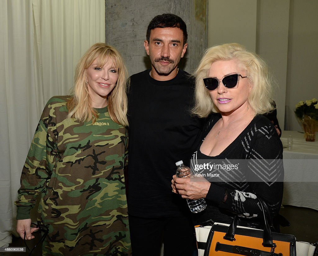 Courtney Love, Riccardo Tisci and Debbie Harry attend Kanye West Yeezy Season 2 during New York Fashion Week at Skylight Modern on September 16, 2015 in New York City.