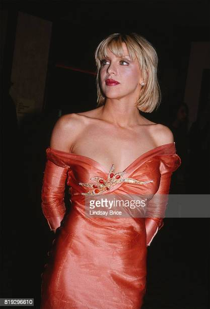 Courtney Love turns to look to her right as she arrives at ACLU Torch of Liberty Dinner at the Century Plaza Hotel Los Angeles on May 21 1997 in Los...