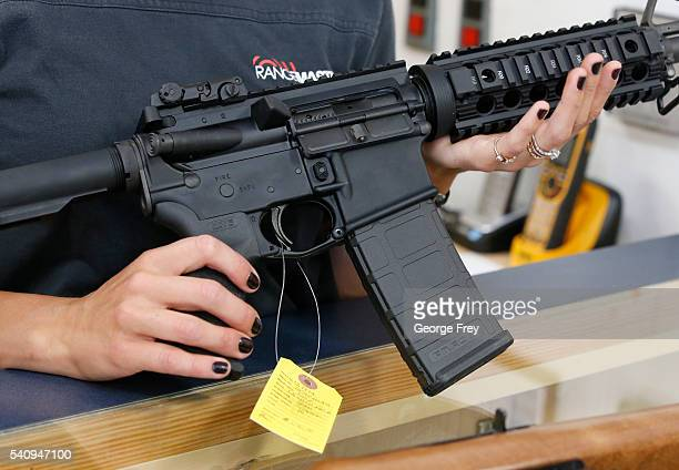 Courtney Manwaring holds an AR15 semiautomatic gun at Action Target on June 17 2016 in Springville Utah Semiautomatics are in the news again after...