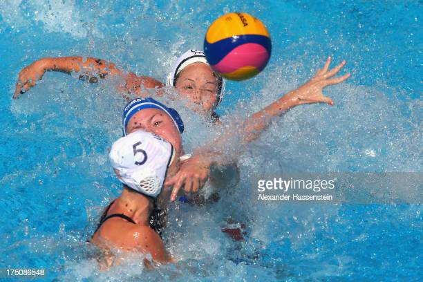 Courtney Mathewson of USA and her team mate Caroline Clark in action with Vivian Sevenich of Netherlands during the Women's Water Polo classification...
